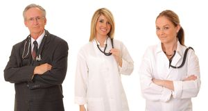 Medical Team. Senior doctor physician and two younger medical team members isolated on white royalty free stock photography