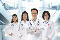 Medical team. Asian medical team standing inside hospital building Royalty Free Stock Photos