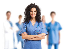 Medical team. Smiling nurse in front of a small medical team Stock Photos