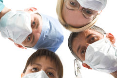 Medical team. Young successful medical team on the white Royalty Free Stock Photography