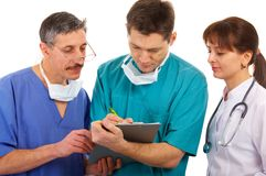 Medical team. Female and male doctors with schedule Stock Photo