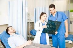 Medical team analyzing MRI results