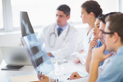 Medical team analyzing Xrays Stock Photo