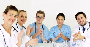 Medical team applauding at the camera