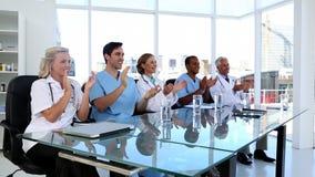 Medical team applauding stock footage