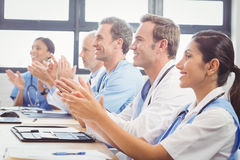 Medical team applauding in conference room. In hospital Royalty Free Stock Photo