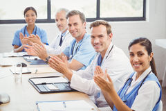Medical team applauding in conference room. Portrait of medical team applauding in conference room Royalty Free Stock Photography