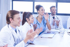 Medical team applauding in meeting Stock Photography