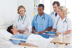 Medical team around the bed of a patient Stock Photography