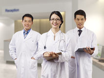 Medical team. Asian medical team standing in hospital lobby royalty free stock photos