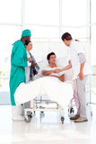 Medical team attending to a patient Stock Photo