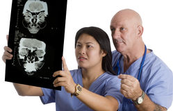 Medical Team checking patients brain xray Royalty Free Stock Photography