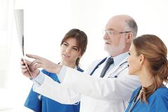 Medical team checking X-ray results royalty free stock photography
