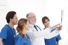 Medical team checking X-ray results stock image