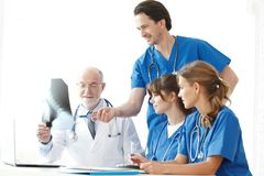 Medical team checking X-ray results royalty free stock images