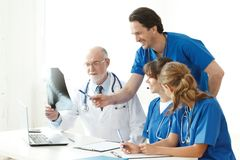 Medical team checking X-ray results royalty free stock photos