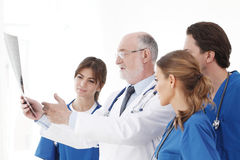 Medical team checking X-ray results stock photos
