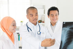 Medical team checking on x-ray image Royalty Free Stock Photography