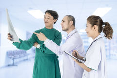 Medical team checking on X-ray results Royalty Free Stock Photo