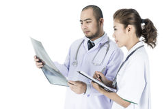 Medical team checking on X-ray results Royalty Free Stock Photography