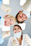 Medical team cheering after operation Stock Image