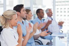 Medical team clapping hands Royalty Free Stock Images