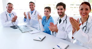 Medical team clapping during a meeting