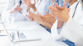 Medical team clapping Stock Photos