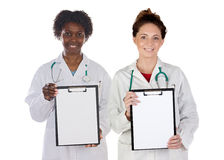 Medical team with clipboard in blank Royalty Free Stock Photography