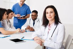 Medical Team Conference. Female Practitioner At Meeting stock images