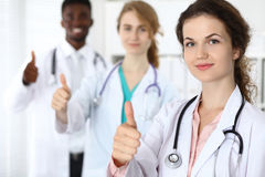 Medical team of confident doctors showing Thumbs up  sign and ready to help. Medicine and health care, insurance concept Royalty Free Stock Photo
