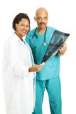 Medical Team With CT Scan Stock Images