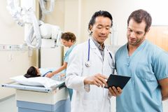 Medical Team With Digital Tablet In Examination Stock Image