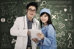 Medical team with digital tablet Royalty Free Stock Photos