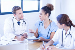 Medical team discussing in meeting Stock Image