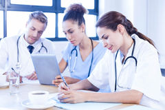 Medical team discussing in meeting Stock Photos