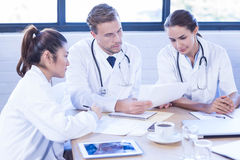 Medical team discussing in meeting Stock Images