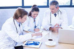 Medical team discussing in meeting Stock Photography
