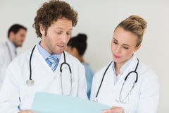 Medical team discussing over file Royalty Free Stock Image