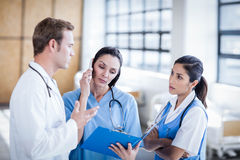 Medical team discussing the report together Stock Images