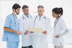 Medical team discussing some results Stock Photography