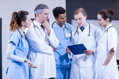 Medical team discussing together Royalty Free Stock Images