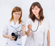 Medical team - a doctor and a nurse holding stetos Stock Photography