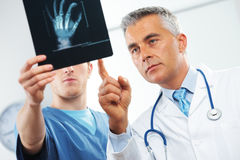 Medical team. Doctor and nurse looking at x ray stock image