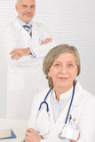 Medical team doctors by desk work computer Stock Photo