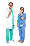 Medical team of doctors holding stethoscope Stock Images