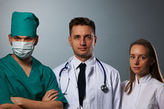 Medical team of doctors. Two men and woman Stock Images