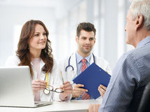 Medical team with elderly patient Stock Photo