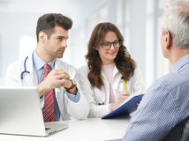 Medical team with elderly patient Royalty Free Stock Image