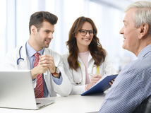 Medical team with elderly patient Royalty Free Stock Images
